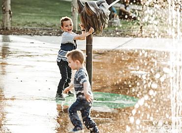 Young boys at a spray park, Edmonton, Alberta, Canada