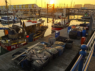 View of Brighton Marina and harbour at sunset, Brighton, East Sussex, England