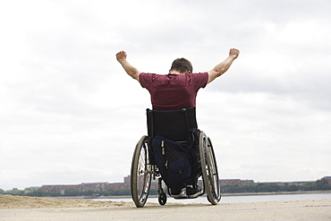 Handicapped man on a wheel chair.