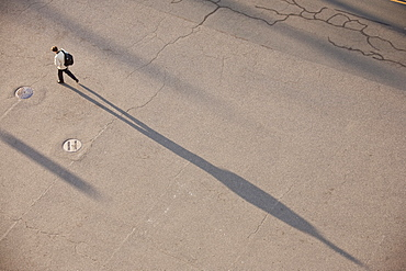 High angle view of a man walking on a street, Drydock Avenue, Boston, Suffolk County, Massachusetts, USA
