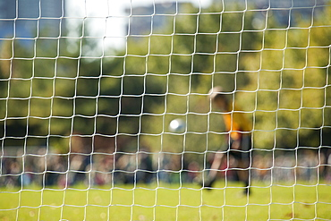 Soccer player viewed through goal net in a soccer field, Teddy Ebersol Field, Charles River, Boston, Suffolk County, Massachusetts, USA