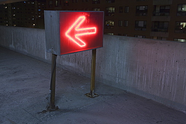Illuminated arrow sign in a garage, Theater District, Boston, Suffolk County, Massachusetts, USA