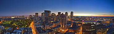 Panoramic view of sunrise in downtown Boston with Boston Harbor, Cambridge and Boston Common and Tremont Street lit up, Boston, Suffolk County, Massachusetts, USA