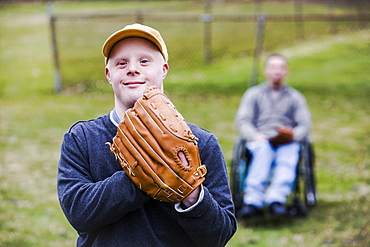 Man with Down Syndrome wearing a baseball glove