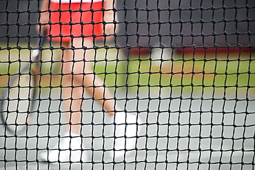 Low section view of a senior woman playing tennis
