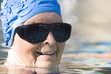 Portrait of a senior woman in a swimming pool
