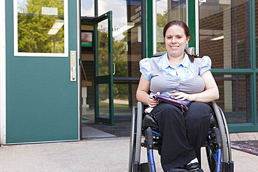 Student in wheelchair with Spina Bifida exiting the school