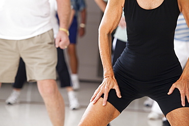 Senior people exercising in an exercising class