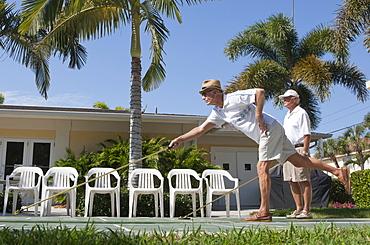 Senior men playing shuffleboard