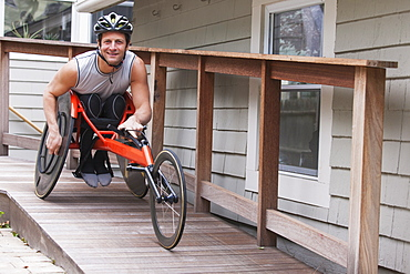 Man with spinal cord injury in disability racing bike