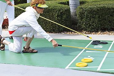 Senior women playing shuffleboard