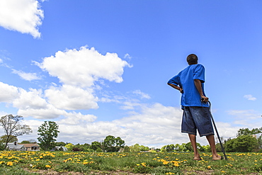 Man with Traumatic Brain Injury standing in a field of flowers