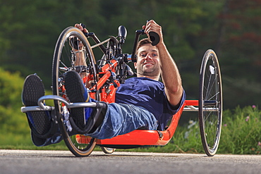 Man with spinal cord injury on his custom adaptive hand cycle
