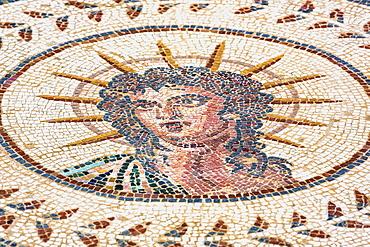Tiled artwork of medusa, Roman ruins of street art; Spain