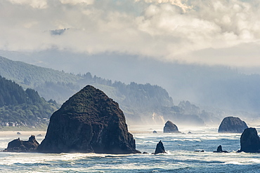 Haystack Rock is a prominent landmark at Cannon Beach on the Oregon Coast; Cannon Beach, Oregon, United States of America