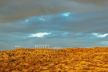 Motel sign and volcanic landscape, Reykjanes Peninsula; Iceland