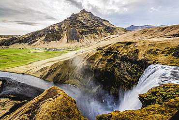 Skogafoss, a landmark waterfall, and Skoga River; Iceland