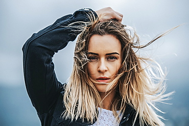 Portrait of a beautiful young woman with windblown hair; Wellington, North Island, New Zealand