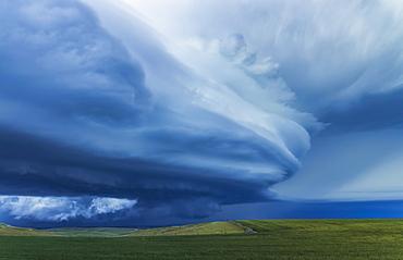 Dramatic dark storm clouds over farmland; Guymon, Oklahoma, United States of America