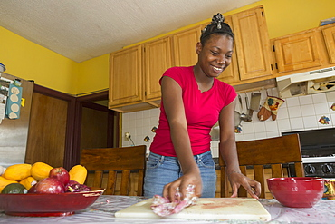 Teen suffering from Bipolar Disorder cleaning the counter