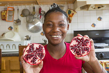 Teen suffering from Bipolar Disorder holding a Pomegranate