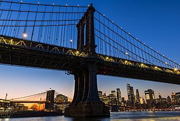 Manhattan Bridge at sunset, Brooklyn Bridge Park; Brooklyn, New York, United States of America
