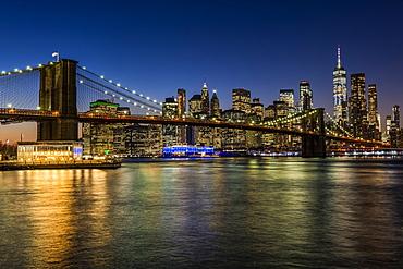 Manhattan skyline and Brooklyn Bridge at twilight, Brooklyn Bridge Park; Brooklyn, New York, United States of America
