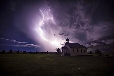 Beautiful and bright electrical storm with a church in the foreground; Moose Jaw, Saskatchewan, Canada
