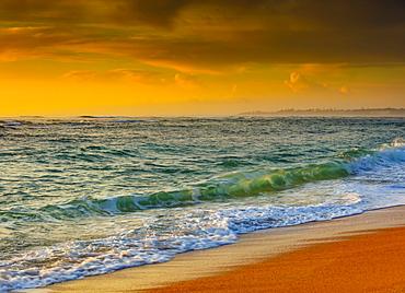 Sunrise over the Pacific Ocean and Lydgate Beach, Lydgate Park; Kapaa, Kauai, Hawaii, United States of America