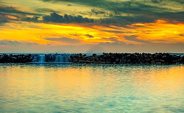 Breakwater off the shore of Lydgate Beach at sunrise, Lydgate Park; Kapaa, Kauai, Hawaii, United States of America