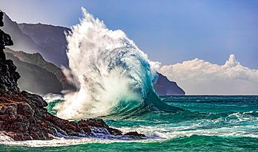 Large waves crashing along the rugged coastline of the Na Pali Coast at Ke'e Beach; Kauai, Hawaii, United States of America