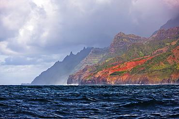 Heavy clouds along the colourful Na Pali Coast, Kalalu Valley; Kauai, Hawaii, United States of America