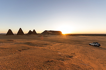 Field of Kushite royal pyramids and Mount Jebel Barkal at sunrise; Karima, Northern State, Sudan