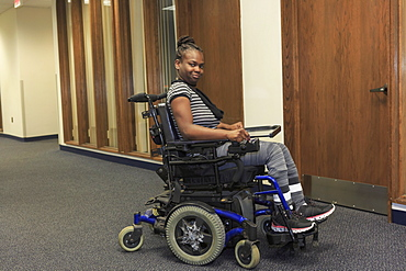 Teen with Cerebral Palsy in hallway of school