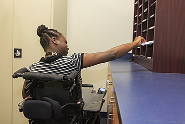Teen with Cerebral Palsy using mailbox