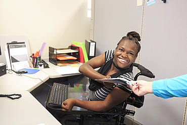 Teen with Cerebral Palsy and Cognitive issues at work