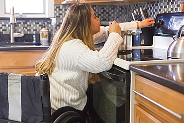 Woman with Spinal Cord Injury cooking