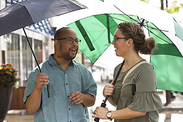 Man with Down Syndrome and friend in rain