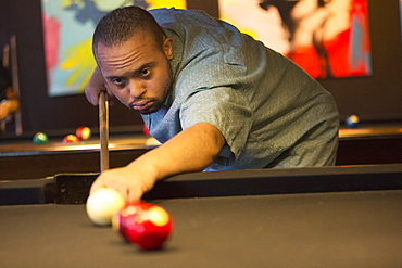Man with Down Syndrome playing pool