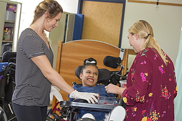 Teen with Spastic Dystonic Cerebral Palsy and assistant at school