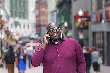 Man with ADHD talking on a mobile phone