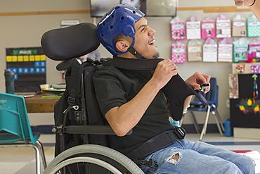 Boy with Spastic Quadriplegic Cerebral Palsy using using his special needs helmet