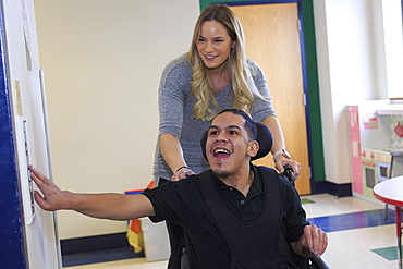 Boy with Spastic Quadriplegic Cerebral Palsy using elevator at school