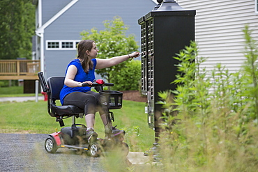 Young Woman with Cerebral Palsy getting the mail