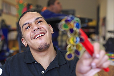 Boy with Spastic Quadriplegic Cerebral Palsy learning at school