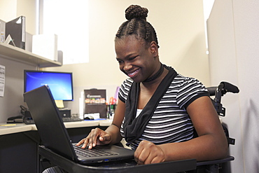 Teen with Cerebral Palsy working in an office