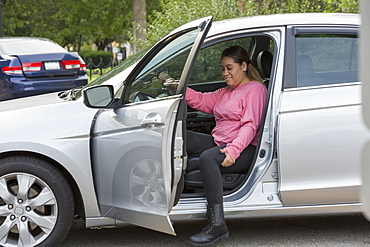 Woman with Spinal Cord Injury getting out her car