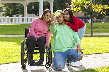 Three friends taking selfie, one with a Spinal Cord Injury