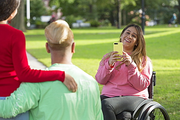 Woman with Spinal Cord Injury taking a picture of her friends