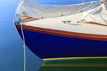 Sailboat bow on mooring in calm water
